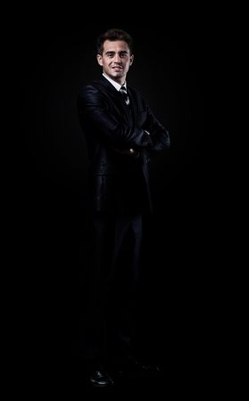 78326345-businessman-isolated-over-black-background
